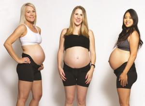 Mama Strut pregnancy support brace user modeling the brace